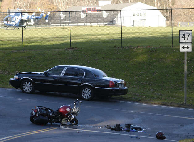 Life Star stands by Saturday afternoon on a nearby Gunnery School athletic field in Washington to transfer an injured motorcyclist to a hospital following a collision with the car seen here at the intersection of routes 47 and 199. Nov. 17, 2012 Photo: Norm Cummings