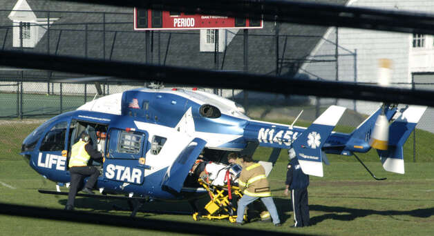 An injured motorcyclist is boarded onto a Life Star helicopter Saturday afternoon on a nearby Gunnery School athletic field in Washington following a collision with a car at the intersection of routes 47 and 199. Nov. 17, 2012 Photo: Norm Cummings