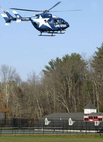 An injured motorcyclist is taken by Life Star helicopter Saturday afternoon from a Gunnery School athletic field in Washington following a collision with a car at the nearby intersection of routes 47 and 199. Nov. 17, 2012 Photo: Norm Cummings