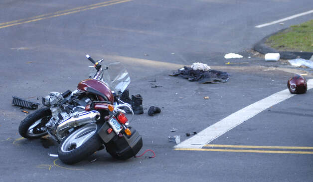 A badly damaged motorcycle awaits cleanup Saturday afternoon in Washington following a collision with a car at the intersection of routes 47 and 199. The motorcyclist was taken by Life Star with undetermined injuries. Nov. 17, 2012 Photo: Norm Cummings