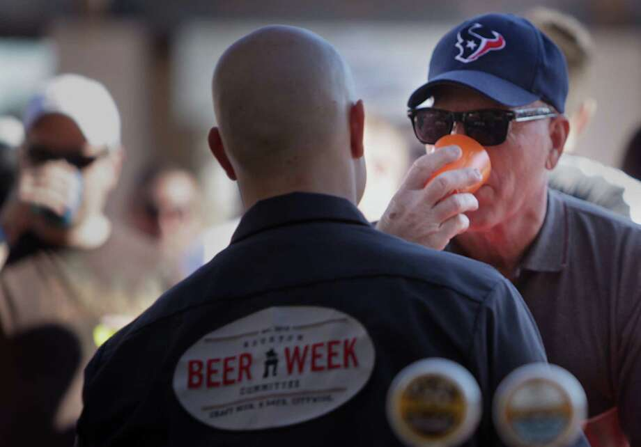 Joey Weiblen of San Antonio samples beer during The Draft, a beer festival feature local and national breweries. Photo: Mayra Beltran, Houston Chronicle / © 2012 Houston Chronicle
