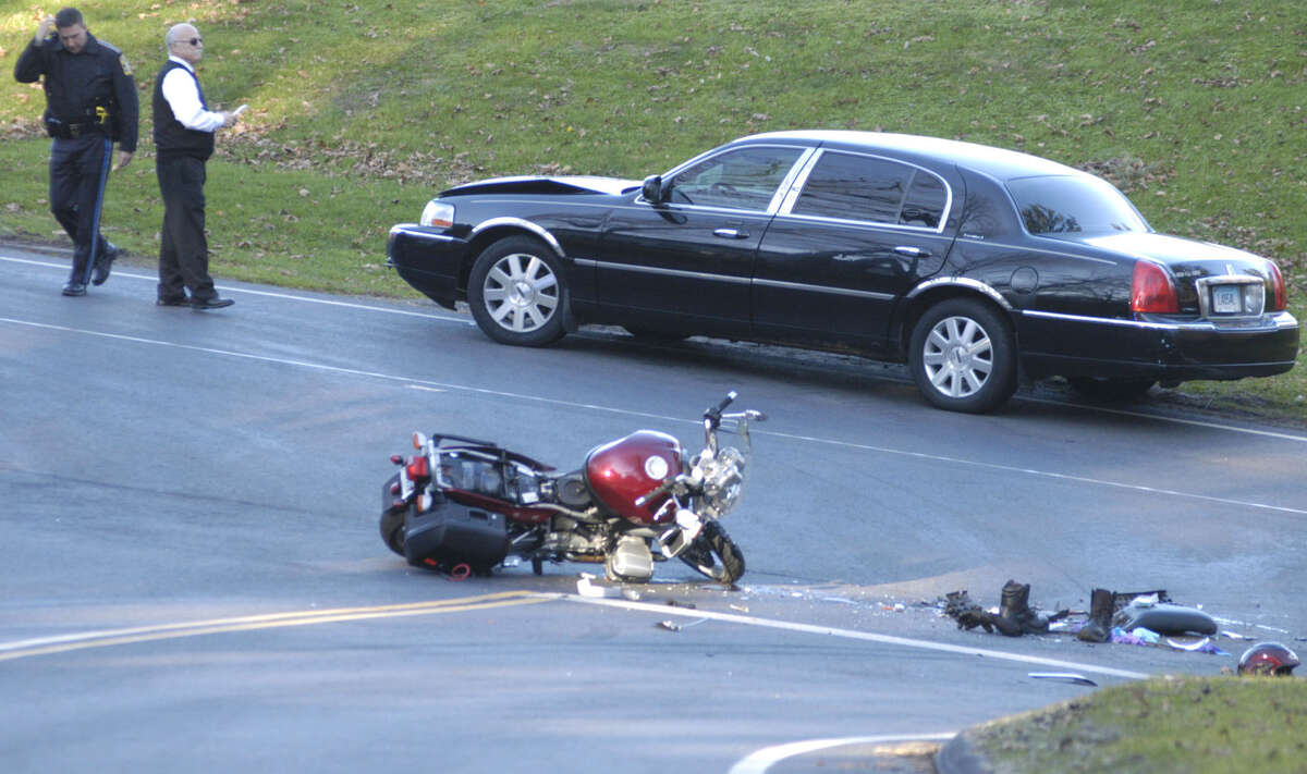 A state policeman investigates the scene of a car vs. motorcycle accident Saturday afternoon at the intersection of routes 47 and 199 in Washington. The driver of the car, apparently uninjured, stands near his vehicle while the motorcyclist was awaiting transfer to a hospital via Life Star helicopter from a nearby Gunnery School athletic field. Nov. 17, 2012