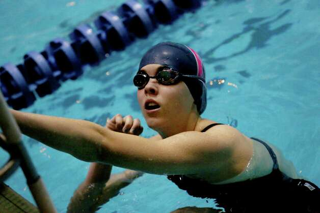 Mike Ross Connecticut Post freelance -Staples High School's Amelia Bullock looks at race results after competing in the 200 IM heat during Saturday's State Open Championships at Yale University's Payne Whitney Gym. Photo: Mike Ross / Connecticut Post Freelance