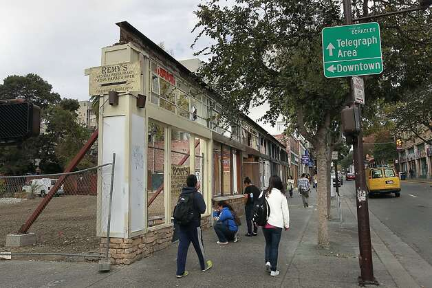 At the corner of Telegraph Avenue and Haste Street, one year after the fire that destroyed several businesses, one damaged building front is kept upright with large beams. Photo: Michael Macor, The Chronicle