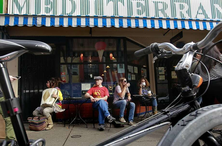 Craig Becker, (center) owner of the Cafe Mediiterania on Telegraph Ave. on Thursday Nov. 15, 2012 in Berkeley, Ca.  The one year anniversary of a structure fire that destroyed several businesses along Telegraph Avenue has left a hole in the street scene leaving local business owners wondering what will replace the loss. Photo: Michael Macor, The Chronicle