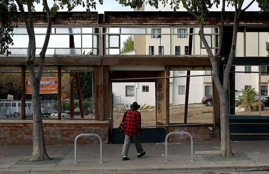 The building front is supported with large beams at the corner of Telegraph Ave. and Haste Street on Thursday Nov. 15, 2012 in Berkeley, Ca.  The one year anniversary of a structure fire that destroyed several businesses along Telegraph Avenue has left a hole in the street scene leaving local business owners wondering what will replace the loss. Photo: Michael Macor, The Chronicle