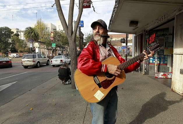 Street musician Steven David Lewis in front of Ameoba Music on Telegraph Ave. on Thursday Nov. 15, 2012 in Berkeley, Ca.  The one year anniversary of a structure fire that destroyed several businesses along Telegraph Avenue has left a hole in the street scene leaving local business owners wondering what will replace the loss. Photo: Michael Macor, The Chronicle