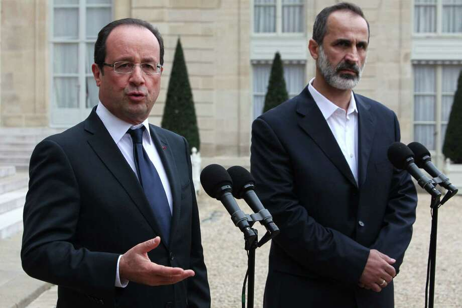 French President Francois Hollande, left, and head of the new Syrian National Coalition for Opposition and Revolutionary Forces Mouaz al-Khatib, right, give a press conference after a meeting, at the Elysee Palace, in Paris, Saturday, Nov. 17, 2012. French President Francois Hollande and the new Syrian opposition leader have announced plans to install a new ambassador to represent Syria in France. The announcement came after talks Saturday at the presidential palace in Paris between Hollande and Moaz al-Khatib, head of the newly formed Syrian opposition coalition. France is the only Western country to have formally recognized the group as the representative of the Syrian people. (AP Photo/Thibault Camus) Photo: Thibault Camus
