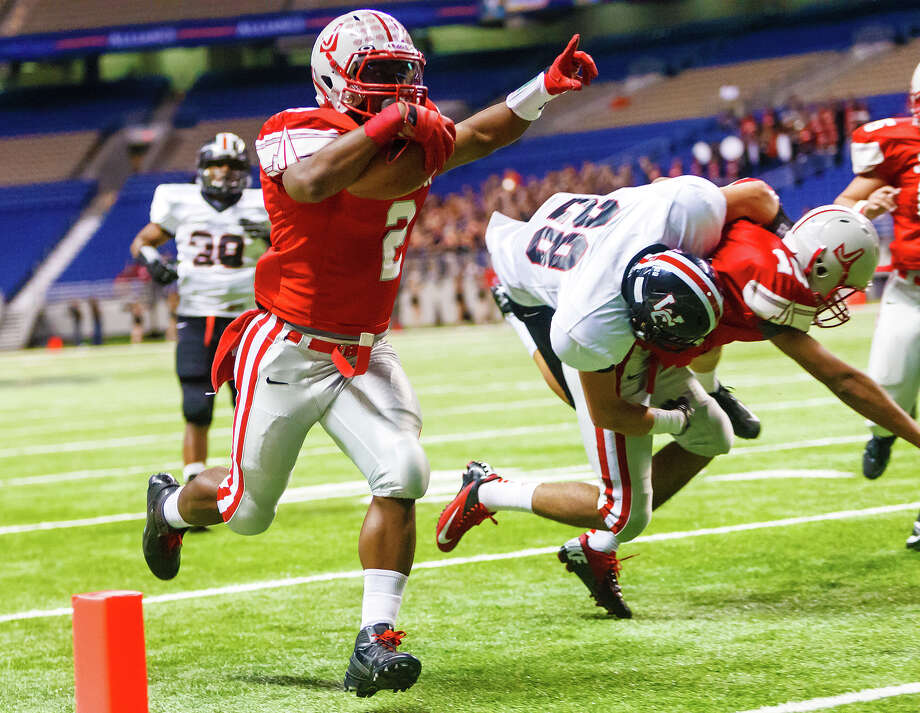 Judson's Jarveon Williams crosses the goal line for a 13-yard touchdown during the first quarter of their Class 5A Division II first round game with Churchill at the Alamodome on Nov 17, 2012.  Judson advanced to the second round with a 34-20 victory over the Chargers.  MARVIN PFEIFFER/ mpfeiffer@express-news.net Photo: MARVIN PFEIFFER, Express-News / Express-News 2012