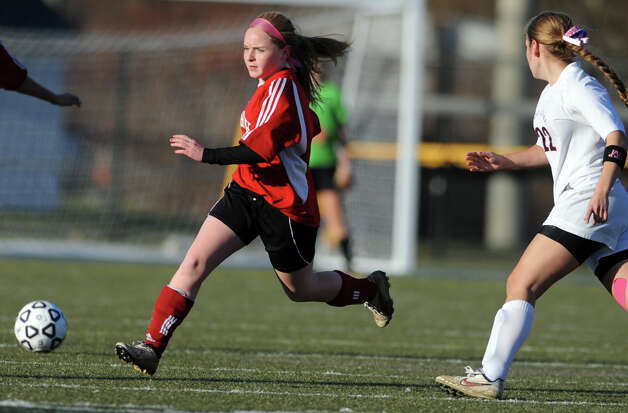 Masuk's Kelsey Brown controls the ball as East Lyme's Erin Doherty defends during the Class L semifinals Saturday, Nov. 17, 2012 at Municipal Stadium in Waterbury, Conn. Photo: Autumn Driscoll / Connecticut Post