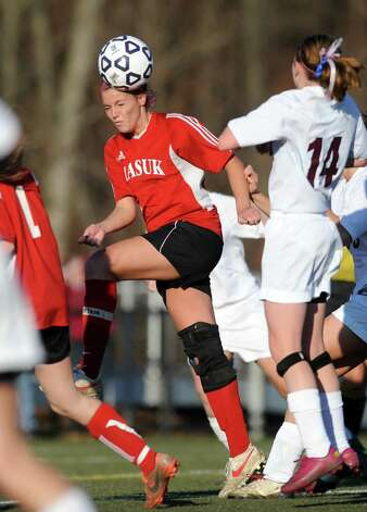 Masuk's Emily Montgomery heads the ball during the Class L semifinals against East Lyme Saturday, Nov. 17, 2012 at Municipal Stadium in Waterbury, Conn. Photo: Autumn Driscoll / Connecticut Post