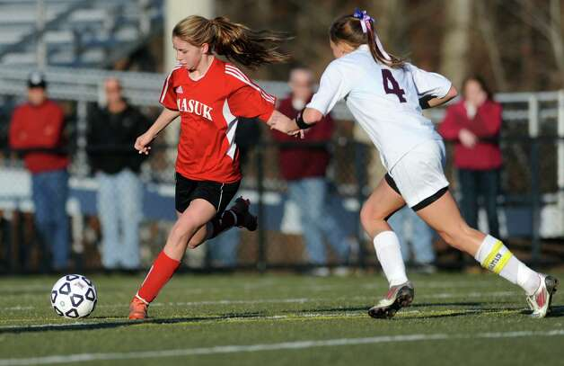 Masuk's 	Jaime Madden controls the ball as East Lyme's Madison Horner defends during the Class L semifinals Saturday, Nov. 17, 2012 at Municipal Stadium in Waterbury, Conn. Photo: Autumn Driscoll / Connecticut Post