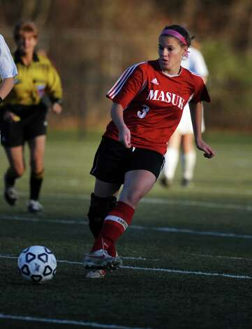 Masuk's Emily Montgomery controls the ball during the Class L semifinals against East Lyme Saturday, Nov. 17, 2012 at Municipal Stadium in Waterbury, Conn. Photo: Autumn Driscoll / Connecticut Post