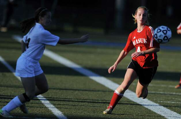 Masuk's Raine Oesterle chases down the ball during the Class L semifinals against East Lyme Saturday, Nov. 17, 2012 at Municipal Stadium in Waterbury, Conn. Photo: Autumn Driscoll / Connecticut Post