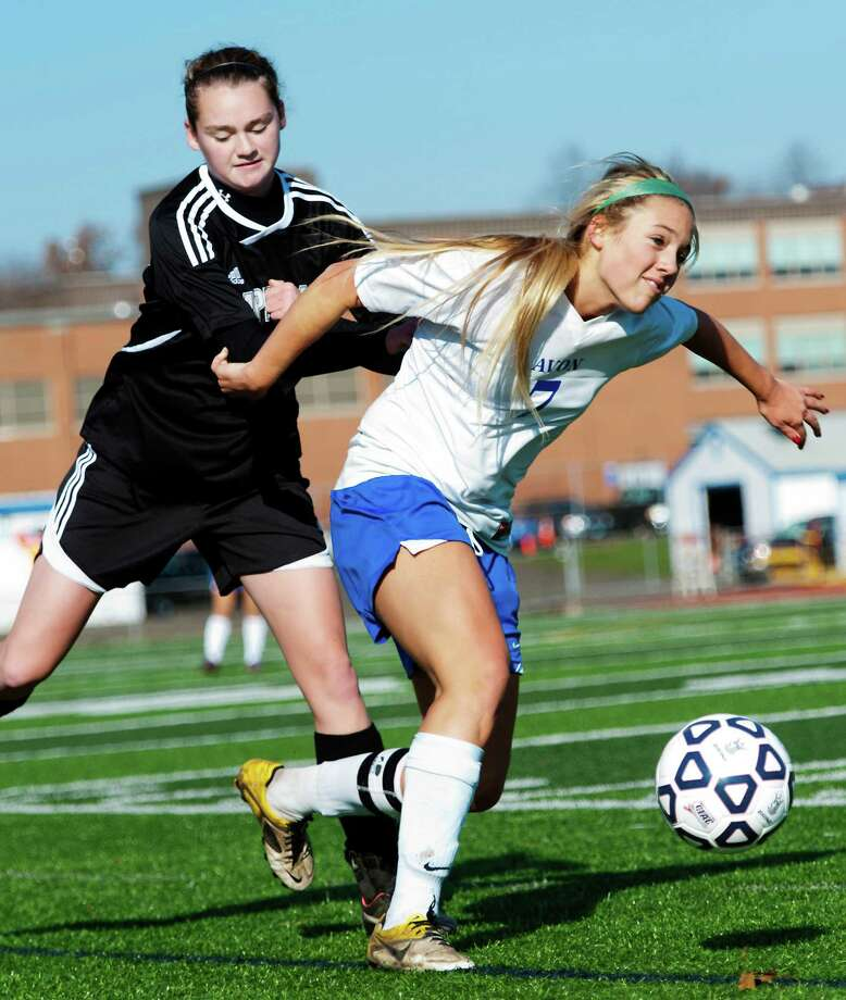 Pomperaug high school's Nicole Murphy and Avon high school's Catherine Jordan battle for the ball in a CIAC class L girls soccer tournament game played at West Haven high school, West Haven, CT on Saturday November 17th, 2012. Photo: Mark Conrad / Connecticut Post Freelance
