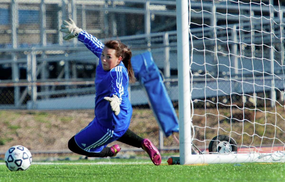 Pomperaug high school goalie Stephanie Alvey couldn't get to this shot on goal in a CIAC class L girls soccer tournament game against Avon high school played at West Haven high school, West Haven, CT on Saturday November 17th, 2012. This was the second of three goals Avon scored today.