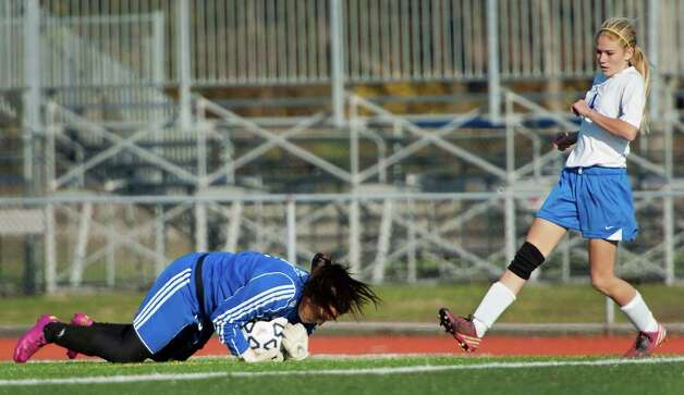 Pomperaug high school goalie Stephanie Alvey makes a save in a CIAC class L girls soccer tournament game against Avon high school played at West Haven high school, West Haven, CT on Saturday November 17th, 2012. Photo: Mark Conrad / Connecticut Post Freelance