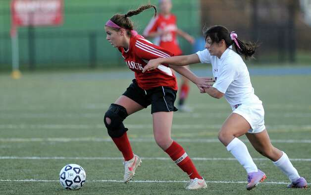 Masuk's Emily Montgomery controls the ball as East Lyme's Jaimee Szupiany defends during the Class L semifinals Saturday, Nov. 17, 2012 at Municipal Stadium in Waterbury, Conn. Photo: Autumn Driscoll / Connecticut Post