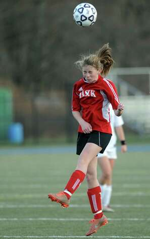 Masuk's Jaime Madden heads the ball during the Class L semifinals against East Lyme Saturday, Nov. 17, 2012 at Municipal Stadium in Waterbury, Conn. Photo: Autumn Driscoll / Connecticut Post