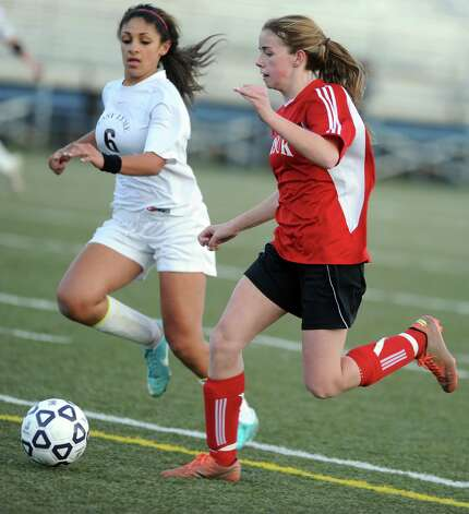 Masuk's Jaime Madden controls the ball as East Lyme's Isabelle Moore defends during the Class L semifinals Saturday, Nov. 17, 2012 at Municipal Stadium in Waterbury, Conn. Photo: Autumn Driscoll / Connecticut Post