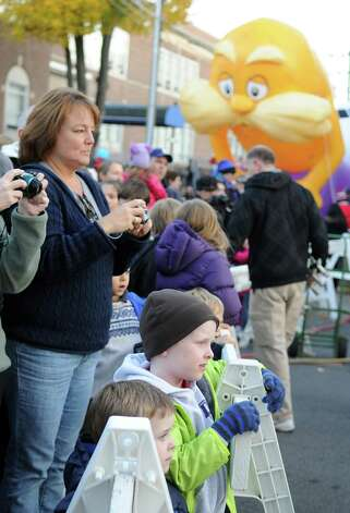 Onlookers watch balloons as they are inflated during Saturday's Balloon Inflation Party near the intersection of Summer and Hoyt Streets in Stamford on November 17, 2012. Photo: Lindsay Niegelberg