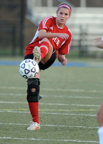 Masuk's Emily Montgomery passes the ball during the Class L semifinals against East Lyme Saturday, Nov. 17, 2012 at Municipal Stadium in Waterbury, Conn. Photo: Autumn Driscoll / Connecticut Post
