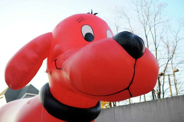 Clifford the Big Red Dog is inflated during Saturday's Balloon Inflation Party near the intersection of Summer and Hoyt Streets in Stamford on November 17, 2012. Photo: Lindsay Niegelberg / Stamford Advocate