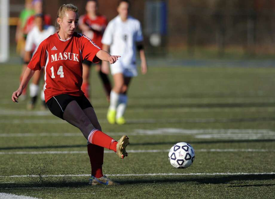 Masuk's Raine Oesterle controls the ball during the Class L semifinals against East Lyme Saturday, Nov. 17, 2012 at Municipal Stadium in Waterbury, Conn. Photo: Autumn Driscoll / Connecticut Post