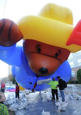 Paddington Bear is inflated during Saturday's Balloon Inflation Party near the intersection of Summer and Hoyt Streets in Stamford on November 17, 2012. Photo: Lindsay Niegelberg / Stamford Advocate
