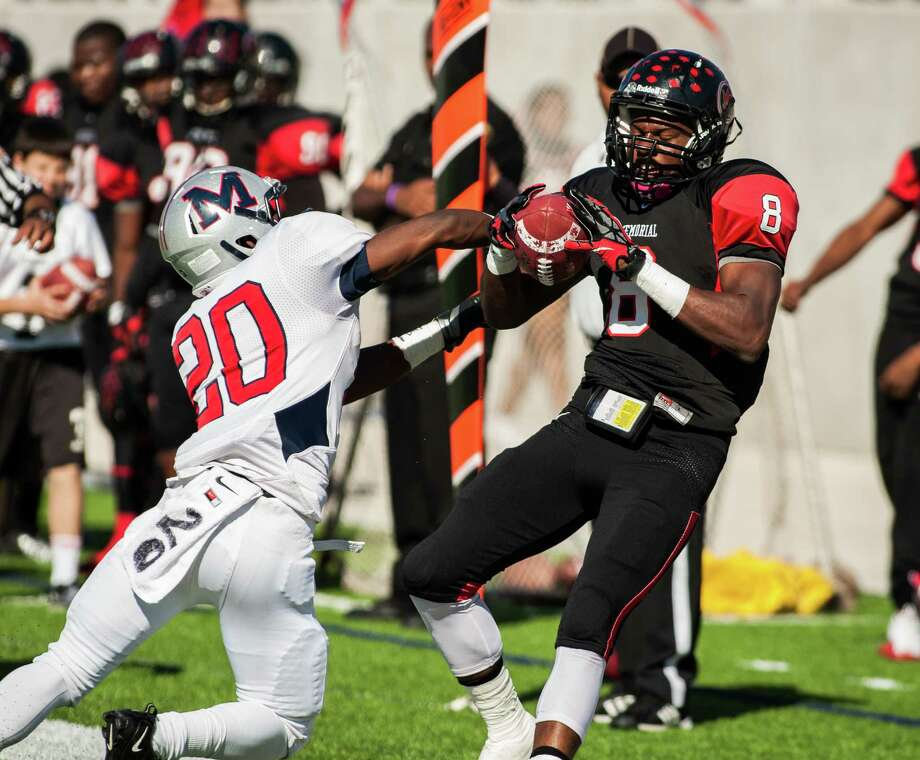 Port Arthur Memorial wide receiver John Leday (8) is knocked out of bounds by Manvel defensive back Gary Haynes (20). Photo: Andrew Richardson, For The Chronicle / © 2012 Andrew Richardson