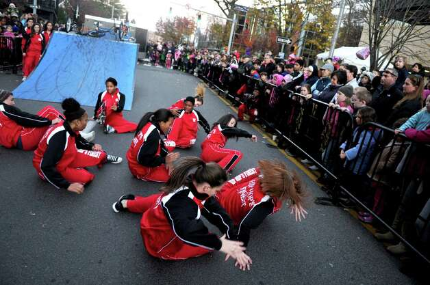 Dancers entertain the crowd during Saturday's Balloon Inflation Party near the intersection of Summer and Hoyt Streets in Stamford on November 17, 2012. Photo: Lindsay Niegelberg / Stamford Advocate