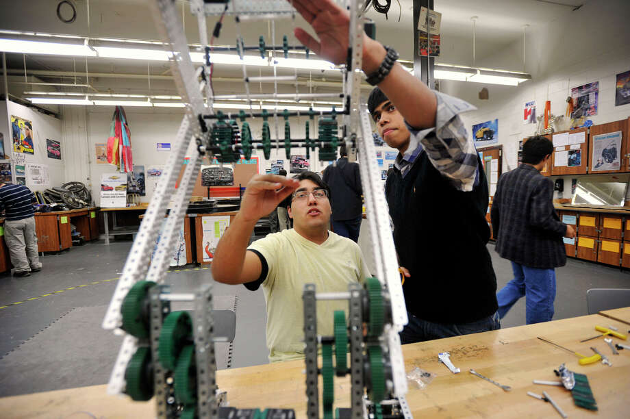 Konstantinos Filippakos, left, and Parviz Alam discuss what they need to do to make their robot better during an after-school work day for the Team 5150 robotics at Danbury High School on Thursday, Nov. 15, 2012. Photo: Jason Rearick / The News-Times