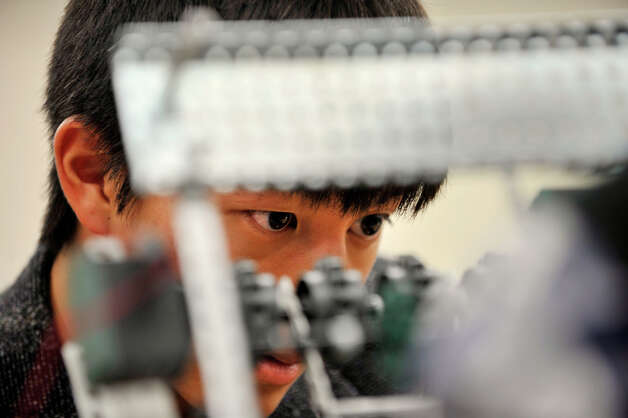 Sean Inouye works on a robot during an after-school work day for the Team 5150 robotics at Danbury High School on Thursday, Nov. 15, 2012. Photo: Jason Rearick / The News-Times
