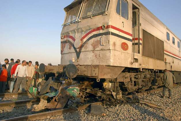 Egyptians gather at the site of a train crash that killed at least 49 people, most of them children between 4 and 6 years old near Assiut  in southern Egypt, Saturday, Nov. 17, 2012. Egyptian security officials say grieving families in the central province of Assiut have cut off roads and denied the prime minister access to the scene of a train accident that killed at least 49 kindergartners. (AP Photo) Photo: Uncredited, Associated Press