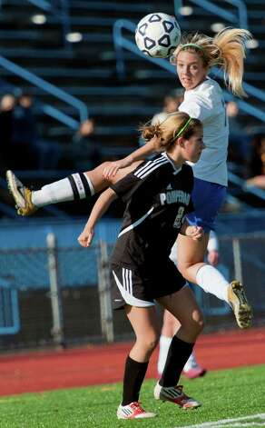 Avon high school's Catherine Jordan heads the ball in a CIAC class L girls soccer tournament game against Pomperaug high school played at West Haven high school, West Haven, CT on Saturday November 17th, 2012. Photo: Mark Conrad / Connecticut Post Freelance