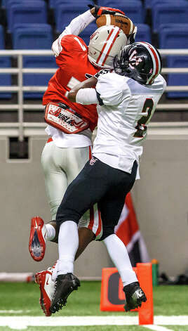 Judson's Tre Flowers (left) intercepts a pass intended for Churchill's Deja Morrow at the goal line during the second quarter of their Class 5A Division II first round game at the Alamodome on Nov 17, 2012.  Judson advanced to the second round with a 34-20 victory over the Chargers.  MARVIN PFEIFFER/ mpfeiffer@express-news.net Photo: MARVIN PFEIFFER, Express-News / Express-News 2012