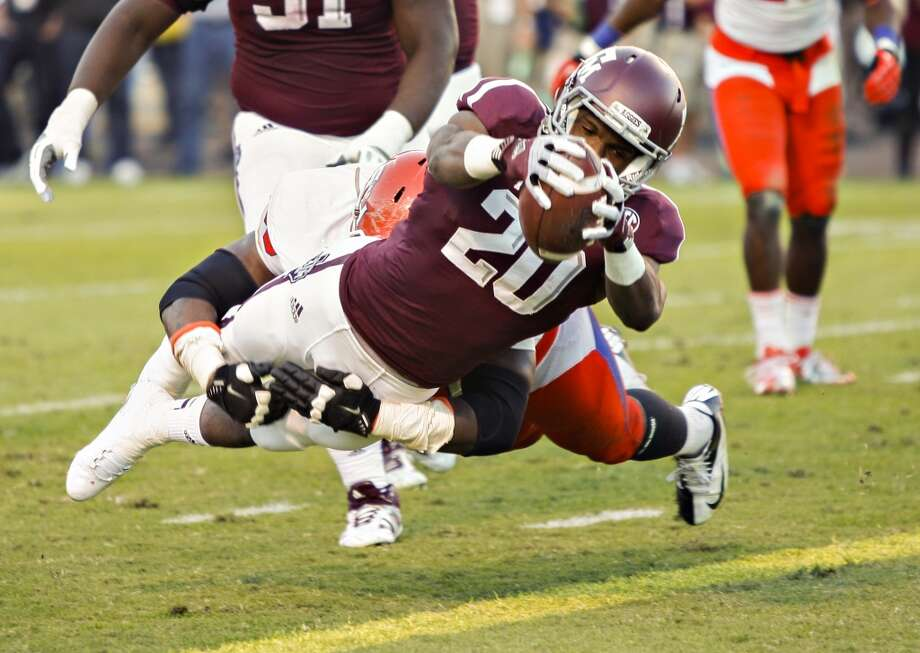 Trey Williams #20 of the Texas A&M Aggies dives for a 6 yard touchdown in the second quarter against the Sam Houston State Bearkats at Kyle Field on November 17, 2012 in College Station, Texas.  (Bob Levey / Getty Images)