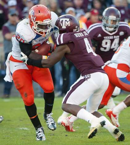 Texas A&M's Toney Hurd (4) tackles Sam Houston State's Timothy Flanders (20) for a loss during the second quarter of an NCAA college football game, Saturday, Nov. 17, 2012, in College Station, Texas.  (Dave Einsel / Associated Press)