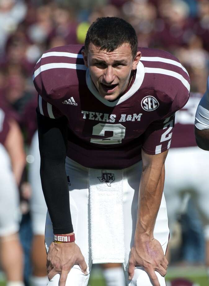 """Texas A&M's Johnny Manziel sings """"The Spirit of Aggieland"""" before an NCAA college football game against Sam Houston State, Saturday, Nov. 17, 2012, in College Station, Texas.  (Dave Einsel / Associated Press)"""