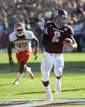 Texas A&M's Johnny Manziel (2) leaves Sam Houston State's Mike Littleton (27) behind on a run during the first quarter of an NCAA college football game, Saturday, Nov. 17, 2012, in College Station, Texas.  (Dave Einsel / Associated Press)