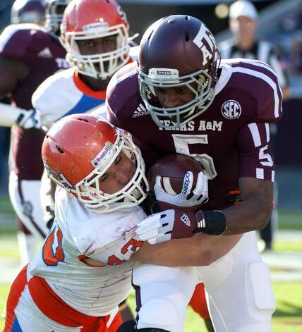 Sam Houston State's Jesse Beauchamp (43) brings down Texas A&M's Kenric McNeal (5) during the second quarter of an NCAA college football game, Saturday, Nov. 17, 2012, in College Station, Texas.  (Dave Einsel / Associated Press)