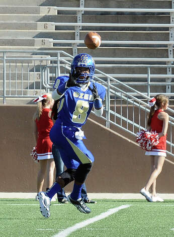 Ozen wide receiver Ronnie Ceaser, 8, on the receiving end of a pass during the Ozen High School Class 4A Division 1 first round game against Crosby High School at Galena Park ISD Athletic Complex on Saturday, November 17, 2012.  Photo taken: Randy Edwards/The Enterprise Photo: Randy Edwards