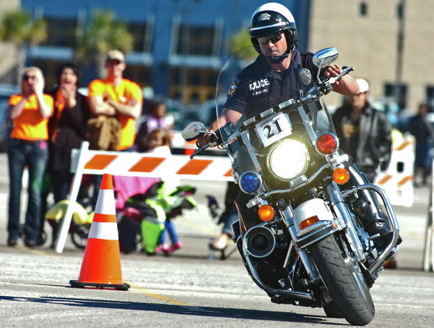 Officer Donnie Williams of the McKinney Police Department threaded expertly through the course at Heroes for Hospice, a motorcycle rodeo hosted by the Beaumont Police Department. The event drew participants from agencies around the region and Louisiana. Photo: Sarah Moore