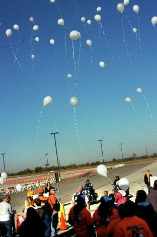 Balloons were released in honor of hospice patients and their caregivers at the opening ceremony of Heroes for Hospice, a motorcycle rodeo hosted by the Beaumont Police Department, which drew participants from agencies around Southeast Texas and Louisiana. Photo: Sarah Moore