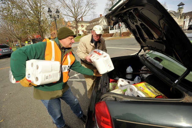 Jim Vigar, left, helps Kent resident Dick Lindsey empty his trunk of donations at the New Milford Tunnel To Towers donation site on Thursday, Nov. 15, 2012. Photo: Jason Rearick / The News-Times
