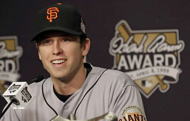 Buster Posey, here receiving the NL Hank Aaron Award at the World Series, isn't eligible for free agency until after the 2016 season, so we have four years to watch. Photo: Patrick Semansky, Associated Press