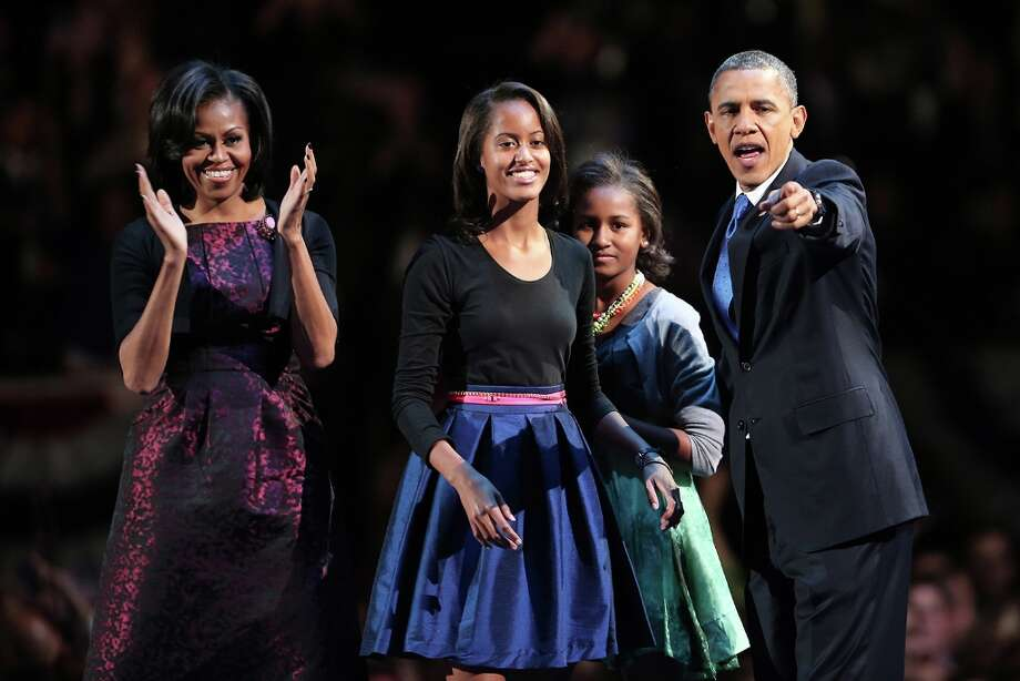 CHICAGO, IL - NOVEMBER 06:  U.S. President Barack Obama stands on stage with first lady Michelle Obama and daughters Sasha and Malia after his victory speech on election night at McCormick Place November 6, 2012 in Chicago, Illinois. Obama won reelection against Republican candidate, former Massachusetts Governor Mitt Romney.  (Photo by Spencer Platt/Getty Images) Photo: Spencer Platt, Getty Images / 2012 Getty Images