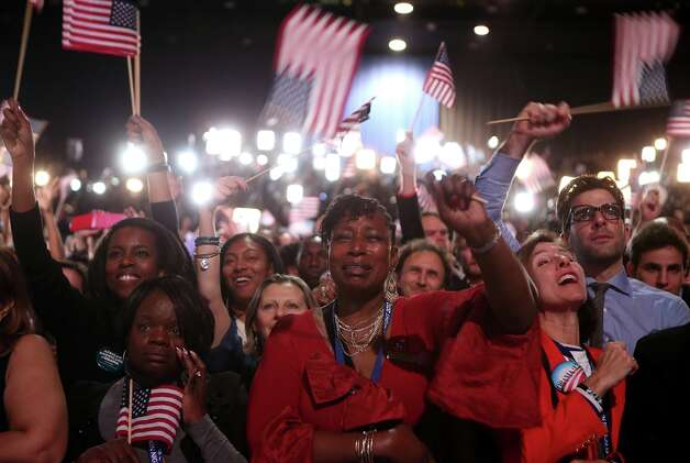 CHICAGO, IL - NOVEMBER 06:  Supporters cheer as U.S. President Barack Obama delivers his victory speech after being reelected for a second term at McCormick Place November 6, 2012 in Chicago, Illinois. Obama won reelection against Republican candidate, former Massachusetts Governor Mitt Romney.  (Photo by Chip Somodevilla/Getty Images) Photo: Chip Somodevilla, Getty Images / 2012 Getty Images