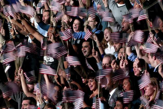 CHICAGO, IL - NOVEMBER 06:  Supporters of U.S. President Barack Obama cheer as they wait for Obama to appear on stage for his victory speech at McCormick Place November 6, 2012 in Chicago, Illinois. Obama won reelection against Republican candidate, former Massachusetts Governor Mitt Romney.  (Photo by Spencer Platt/Getty Images) Photo: Spencer Platt, Getty Images / 2012 Getty Images