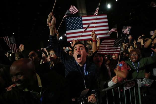 CHICAGO, IL - NOVEMBER 06:  Supporters of U.S. President Barack Obama cheer after networks project Obama as reelected during the Obama Election Night watch party at McCormick Place November 6, 2012 in Chicago, Illinois. Networks project Obama has won reelection against Republican candidate, former Massachusetts Governor Mitt Romney.  (Photo by Chip Somodevilla/Getty Images) Photo: Chip Somodevilla, Getty Images / 2012 Getty Images